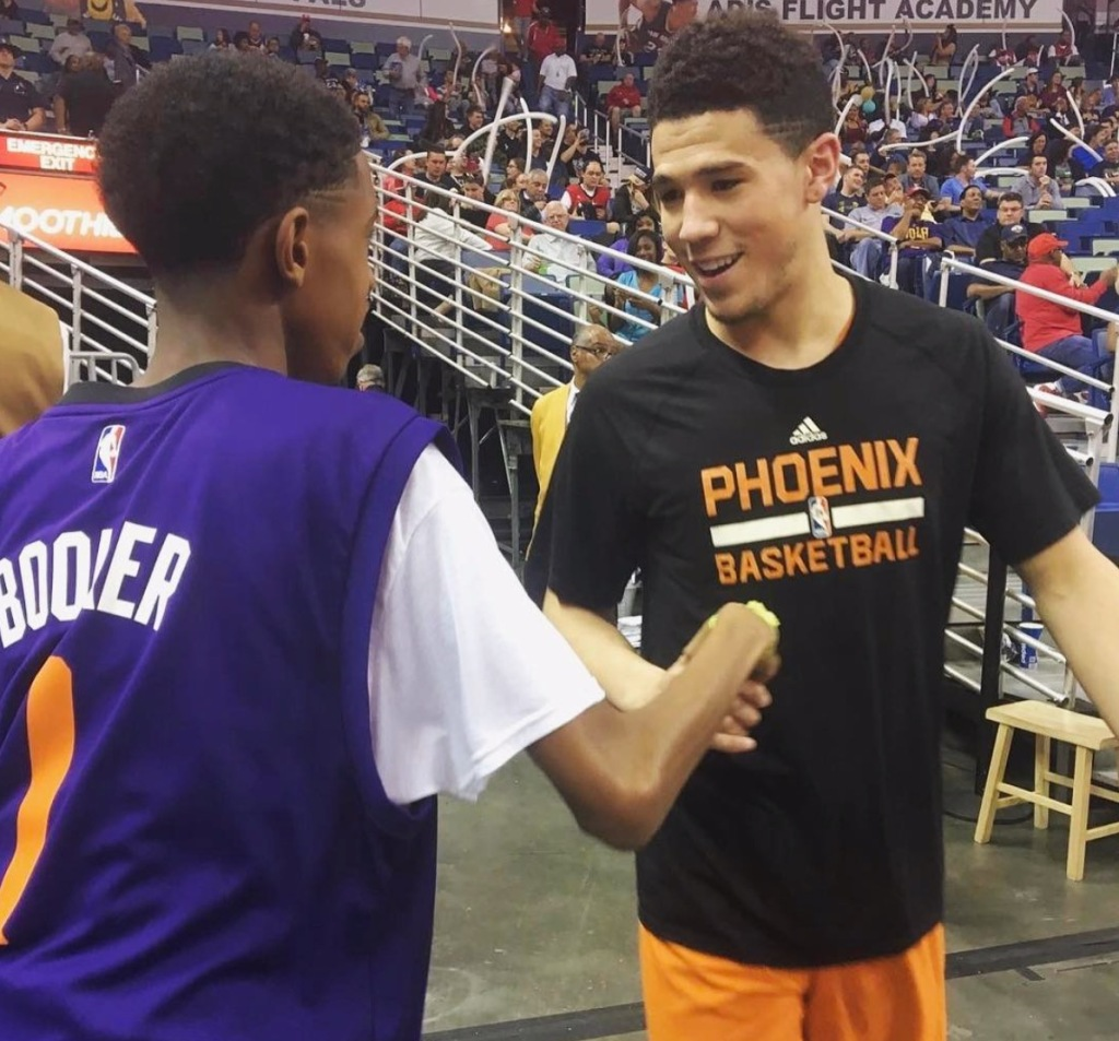 Phoenix Suns NBA player Devin Booker with fan